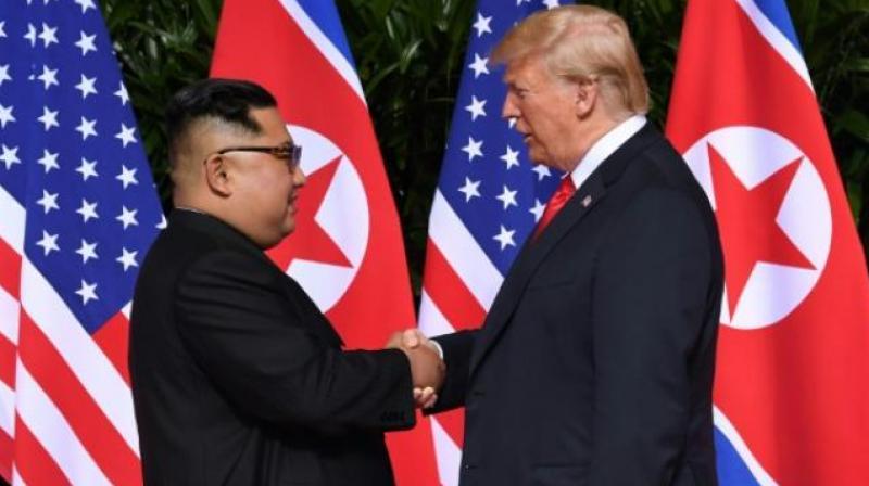 President Donald Trump shakes hands with North Korean leader Kim Jong-un during their meet on Sentosa Island, Singapore. (Photo: AP)