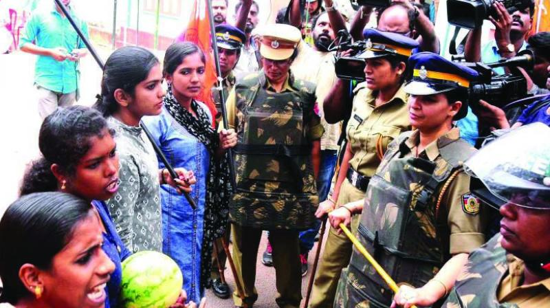 Police personnel block the protest rally taken out by girl students in front of Farook Training College. (Photo: Asian Age/File)
