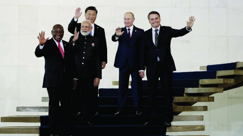 PM Narendra Modi with South Africa's President Cyril Ramaphosa (from left), Chinese President Xi Jinping, Russian President Vladimir Putin and Brazil's President Jair Bolsonaro during the Brics summit at the Itamaraty Palace in Brasilia, Brazil. (Photo: AP)