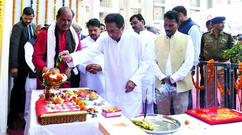 Madhya Pradesh CM Kamal Nath performs rituals during foundation laying ceremony of proposed residential flats for police personnel under housing project in Bhopal on Wednesday. (Photo: PTI)