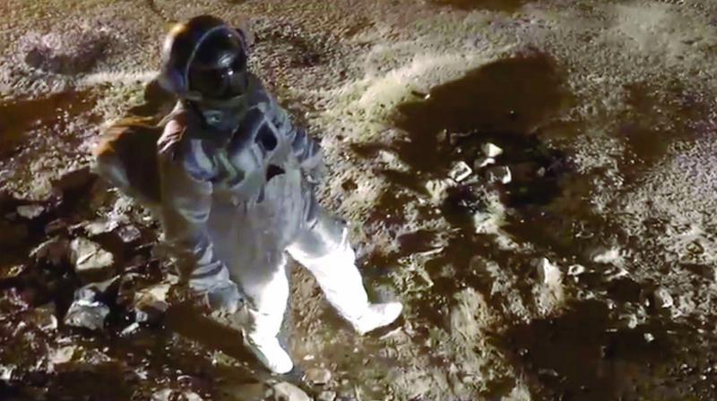 Screenshot from the vedio where Baadal walks through the roads of Bengaluru dressed as an astronaut.