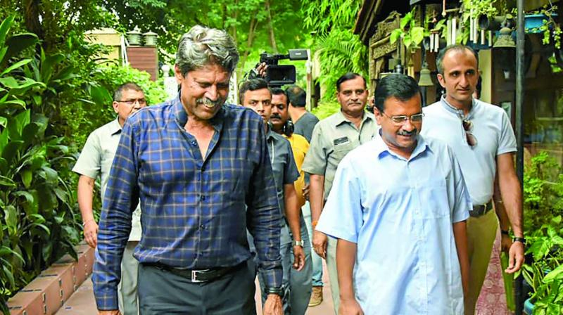 Chief minister Arvind Kejriwal visits the residence of former cricketer Kapil Dev as part of the 10-week anti-dengue drive in New Delhi on Sunday. (Photo: PT)I