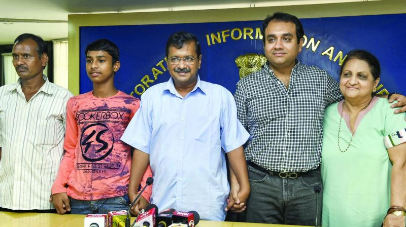 CM Arvind Kejriwal with Vijay Kumar who cracked the IIT entrance examination at a press conference in New Delhi on Sunday. (Photo: PTI)