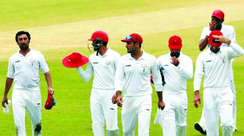 Afghanistan players walk back to the pavilion at the end of day four. (Photo: ICC)