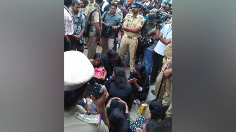 'Police is asking us to go back in view of protests. But, we won't go back without darshan,' Selvi, coordinator of the outfit, said. (Photo: Twitter | ANI)