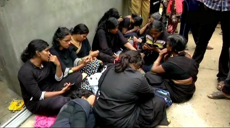 Repeated talks by the police with the women who were sitting on the road for over six hours, also failed as they insisted on climbing the hill and have darshan at the shrine. (Photo: ANI)