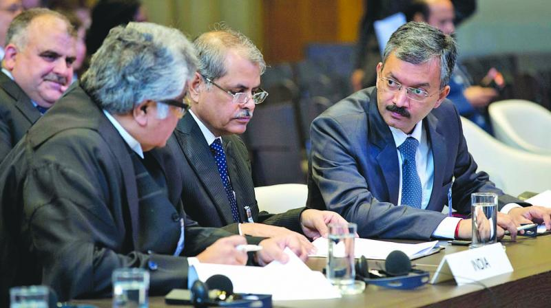 Top Supreme Court advocate Harish Salve (left), who represented the Indian government, and MEA joint secretary Deepak Mittal (right), along with the rest of the Indian delegation, wait for judges to enter the World Court in The Hague, Netherlands. (Photo: AP)