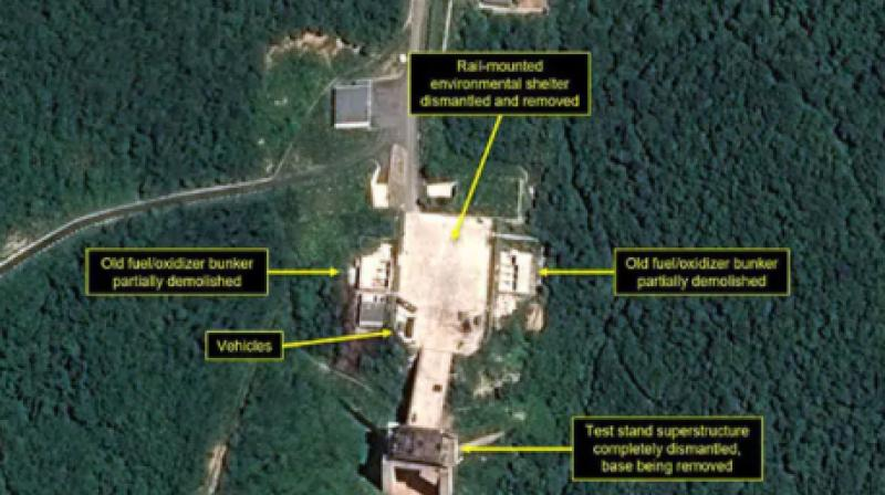 According to the respected 38 North group, commercial satellite imagery of the Sohae satellite launching station indicates Pyongyang has begun taking down a processing building and a rocket-engine test stand that had been used to test liquid-fuel engines for ballistic missiles and space launch vehicles. (Photo: AFP)