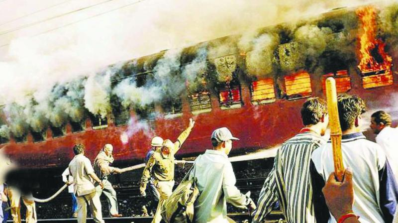 Coach S-6 of the Sabarmati Express, in which 59 people, mostly 'kar sevaks' returning from Ayodhya were travelling, was burnt on February 27, 2002 at the Godhra station, triggering riots in the state. (Photo: PTI/File)