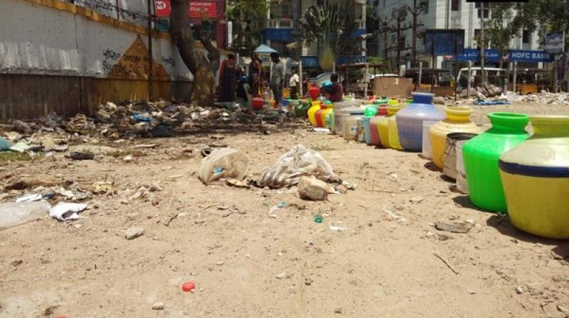 'We have to stand in a queue for hours under this scorching heat to fetch some water as borewells in the area have gone dry. This is for the third time in a row that Chennai is facing a severe water crisis,' the local also said. (Photo: ANI)