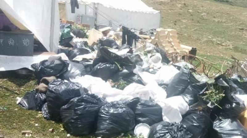 The municipal corporation has deployed 20 workers to clear the waste lying around in the area. (Photo: ANI)