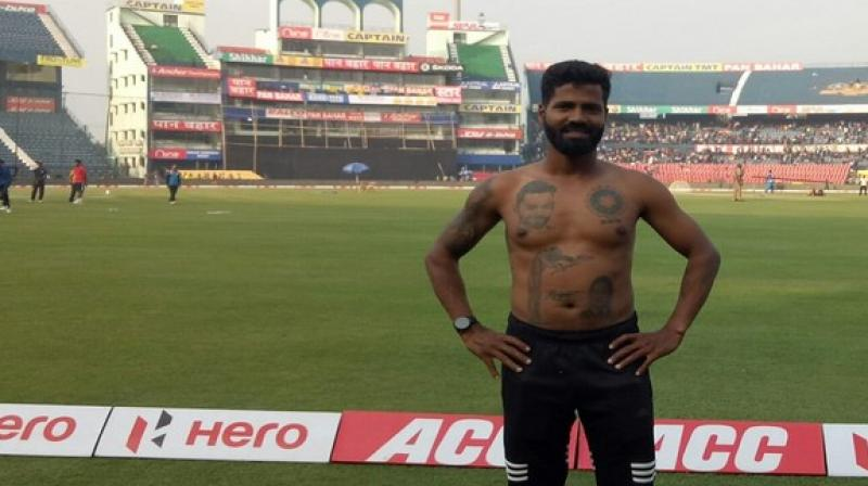 As India is gearing up to compete in the series decider against West Indies, Pintu Behera, an ardent fan of Virat Kohli from Berhampur, has inked 16 permanent tattoos of the skipper, including his Jersey No. 18, on his body. (Photo:ANI)