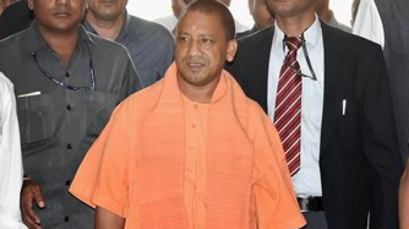 UP Chief Minister Yogi Adityanath arrives for a meeting with police officers at Lok Bhawan in Lucknow. (Photo: AP)