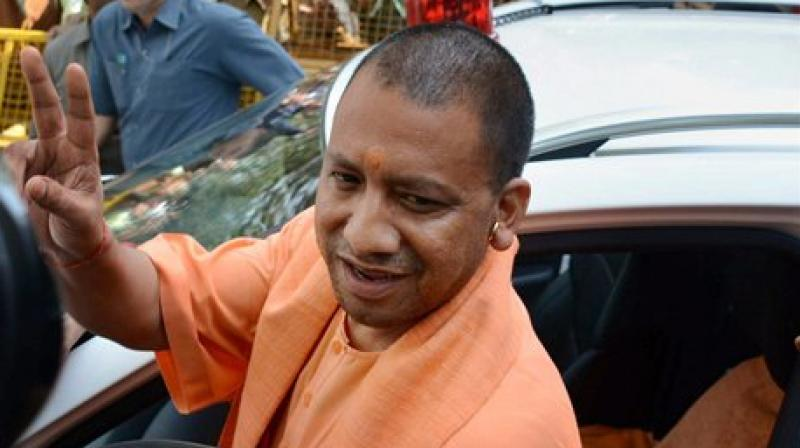 Uttar Pradesh Chief Minister Yogi Adityanath leaves after a meeting in Lucknow. (Photo: AP)