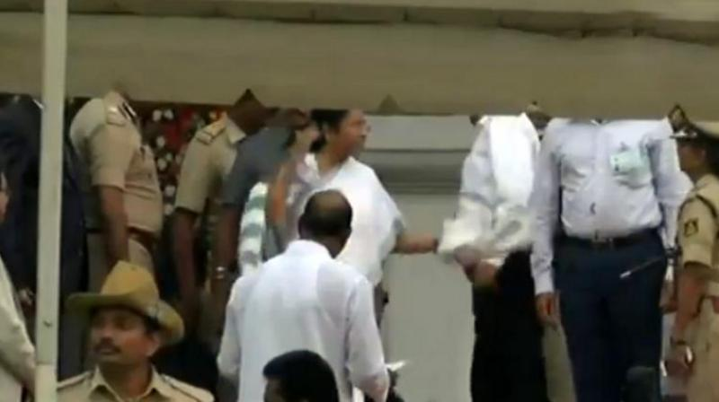 West Bengal Chief Minister Mamata Banerjee appears to have lost her cool and reprimanded Karnataka's DGP for being made to walk to reach the Vidhana Soudha for the swearing-in ceremony. (Photo: ANI | Screengrab)