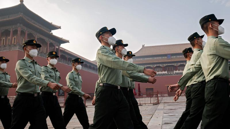 A file photo of the PLA soldiers marching at the forbidden city in China. — PTI photo