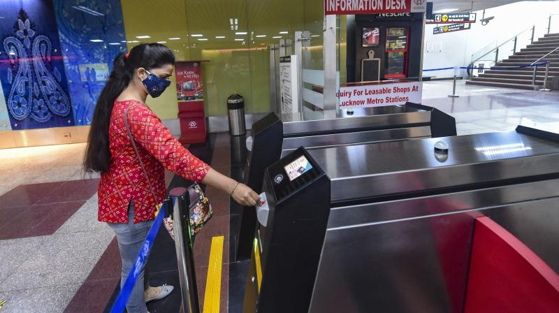 A passenger enters a metro concourse as Lucknow Metro resumes services after over five months suspension due to COVID-19 outbreak, in Lucknow, Monday. — PTI photo
