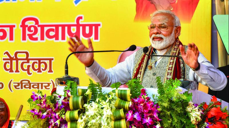 Prime Minister Narendra Modi addresses the closing ceremony of the centenary celebrations of Shri Jagadguru Vishwaradhya Gurukul at Jangamwadi Math in Varanasi on Sunday. (Photo: PTI)