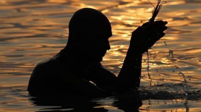 Devotee praying (Photo: AP)