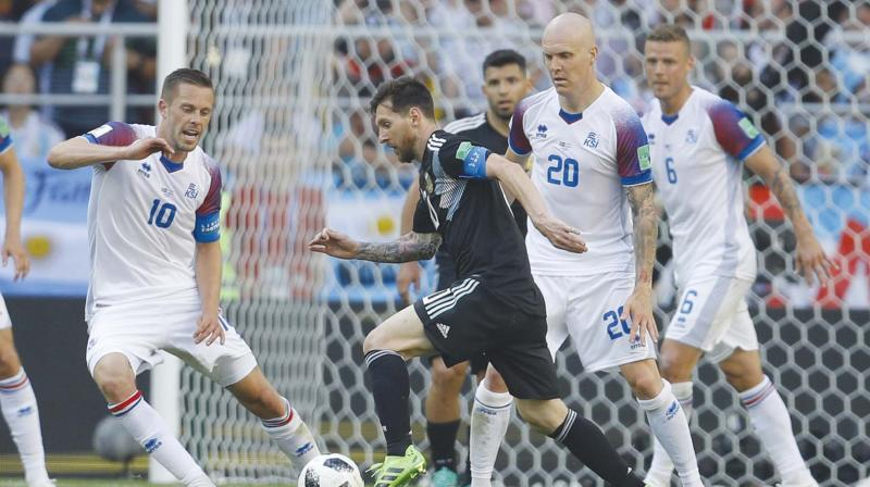 Argentina captain Lionel Messi (centre) tries to get past Iceland players in  their Group 1da614154d6a1