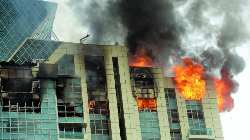 A view of the blaze which gutted the duplex on the 32nd and 33rd floors of the C wing of Beau Monde Towers in Prabhadevi. (Photo: Rajesh Jadhav)