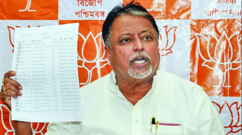 BJP leader Mukul Roy interacts with media people  during a press conference, in Kolkata on Saturday. (Photo: PTI)