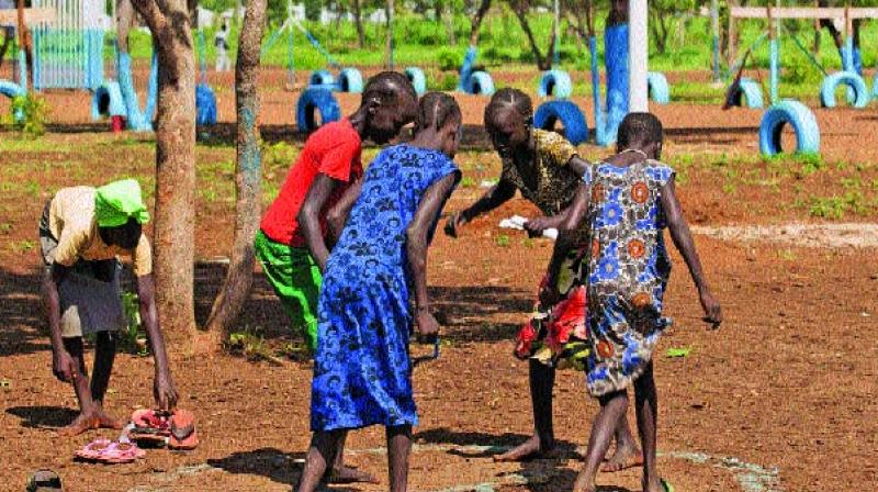 Unaccompanied children who travelled alone from South Sudan to the Ethiopian border play at the children friendly space of Plan International Nguenyyiel refuge camp in Gambela, Ethiopia. (Photo: AFP)