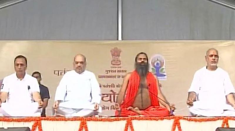 Yoga guru Ramdev, political leaders perform yoga on International Yoga Day. (Photo: Twitter | ANI)