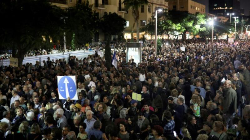 Israelis take part in a demonstration under the name
