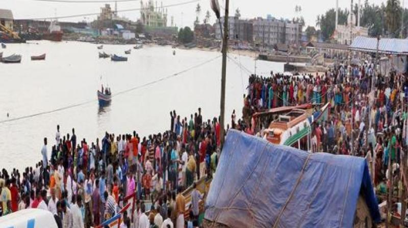 Altogether 809 fishermen with their boats from Tamil Nadu and Kerala were swept away and reached Maharashtra coast where they were provided food and shelter. (Photo: PTI)