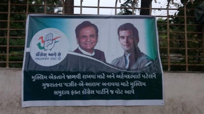 The posters that came up in old city area and Surat-East constituency of the diamond and trading hub which goes to polls on Saturday carried photos of Congress vice president Rahul Gandhi and Ahmed Patel. (Photo: ANI | Twitter)