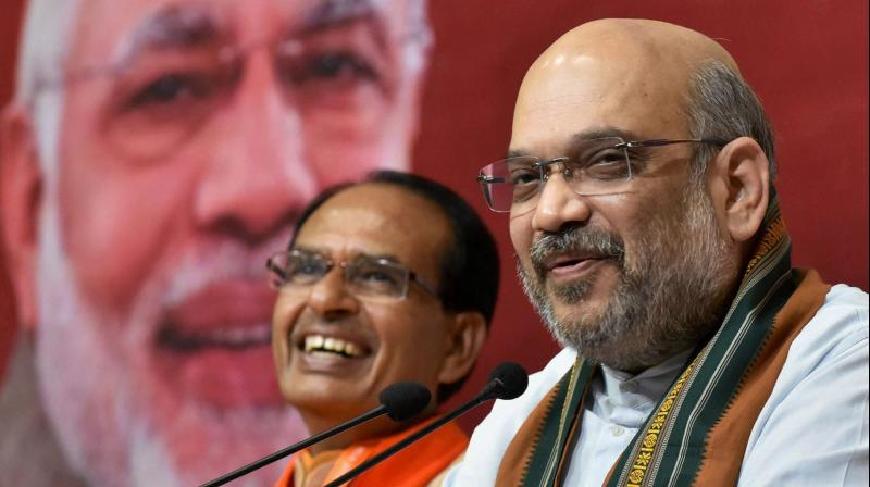 BJP President Amit Shah addressing a press conference at the party's state headquarters in Bhopal. (Photo: PTI/File)