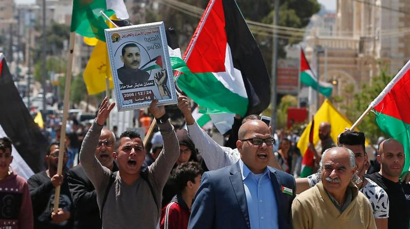 Palestinian officials said some 1,500 inmates affiliated with all political factions including rival Fatah and Hamas were taking part in the protest. (Photo: AFP)