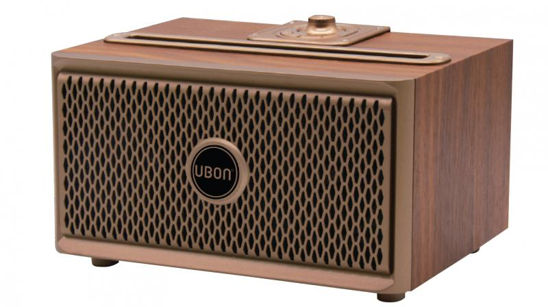 The UBON SP-50 Wooden wireless speaker can be carried into a backpack, suitcase, or travel bag.