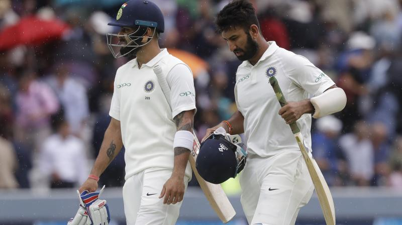 To share the onus of India's fort with Pujara, skipper Virat Kohli came out to the crease amid a few boos ringing around as the match resumed. (Photo: AP)