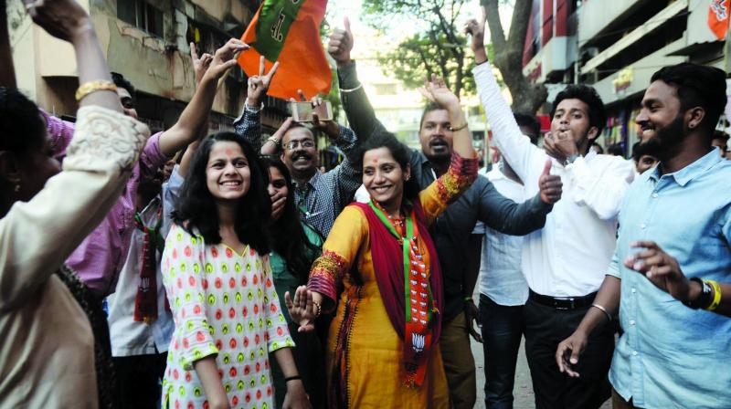 Elated BJP workers celebrate outside the BJP party office in Dadar after the results were declared. (Photo: Shripad Naik)