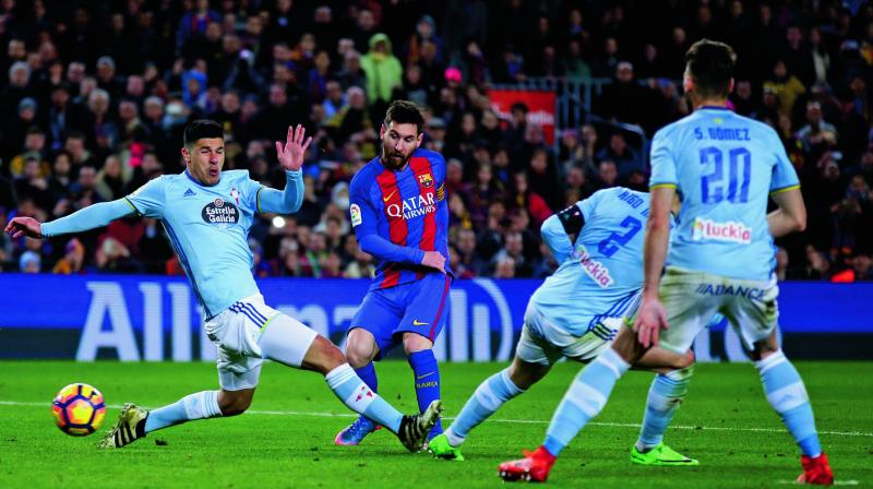 Barcelona's Lionel Messi scores against Celta Vigo in their La Liga match at Camp Nou in Barcelona on Saturday. The hosts won 5-0. (Photo: AP)