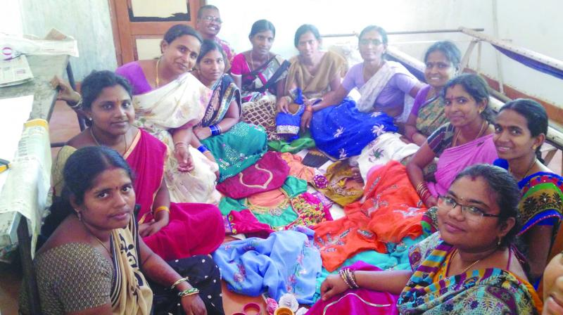 Women in T. Sirasapalli village with the clothes and bangles they created after watching DIY videos on YouTube.