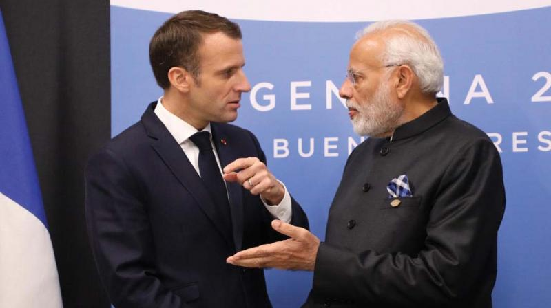 France's President Emmanuel Macron and Prime Minister Narendra Modi speak during a bilateral meeting on the second day of the G-20 Leaders' Summit in Buenos Aires on December 1, 2018. (Photo: AFP)