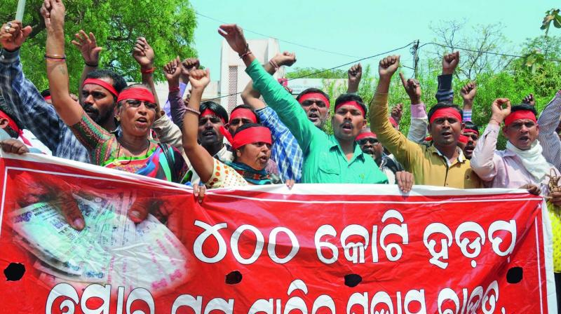 Duped investors at a rally in Bhubanewar protest against the Odisha government's alleged inaction to ensure refund of money collected by chit fund firms.
