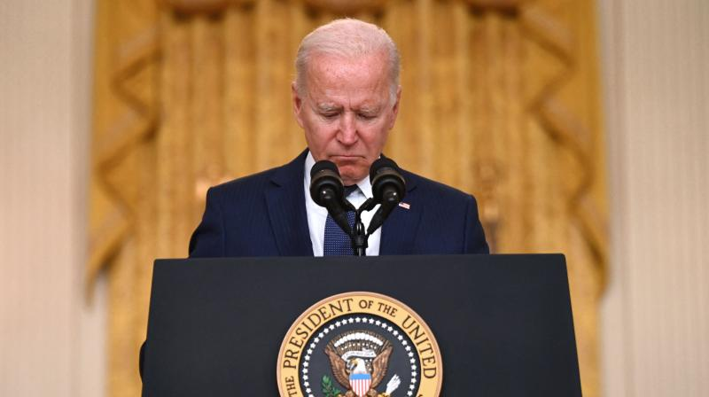US President Joe Biden pauses as he delivers remarks on the terror attack at Hamid Karzai International Airport, and the US service members and Afghan victims killed and wounded, in White House, Washington, DC on August 26, 2021.