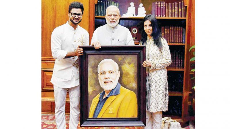 Artist Suvigya Sharma with wife Charu Sharma and PM Narendra Modi.
