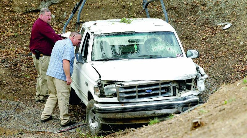 Investigators view a pickup truck involved in a deadly shooting at the Rancho Tehama Reserve, near Corning, California. (Photo: AP)