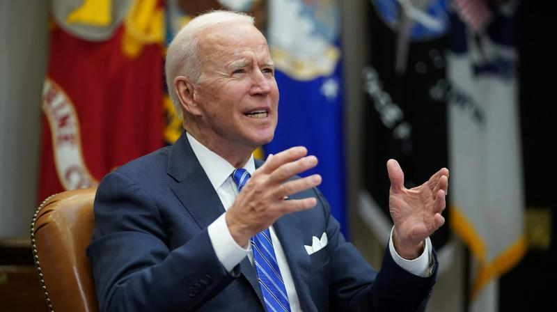 US President Joe Biden gestures as he speaks during a virtual call to congratulate the NASA JPL Perseverance team on the successful Mars landing, in the Roosevelt Room of the White House in Washington, DC on March 4, 2021. (MANDEL NGAN / AFP)