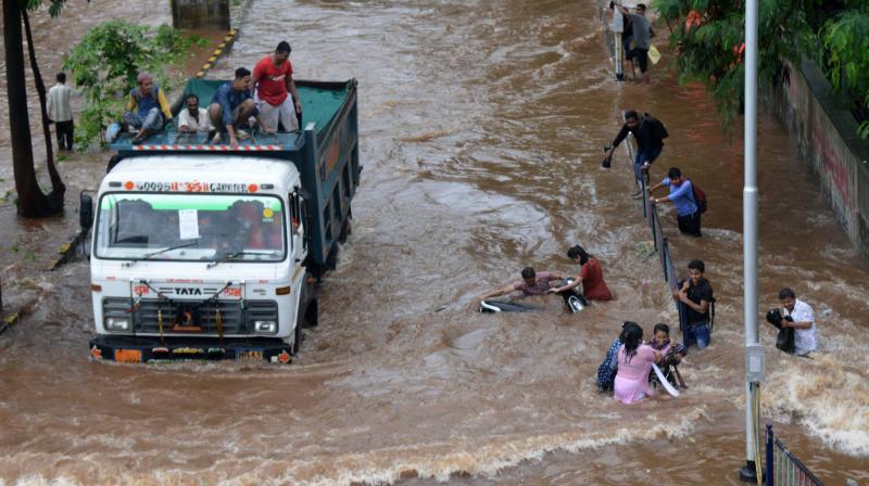 Traffic reduced to a crawl as heavy rains lash Mumbai on Wednesday. (Photo: Rajesh Jadhav)