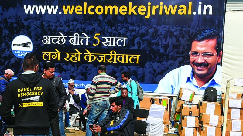 Aam Aadmi Party workers prepare for the upcoming Delhi Assembly elections at the party office in New Delhi on Tuesday. (Photo: PTI)