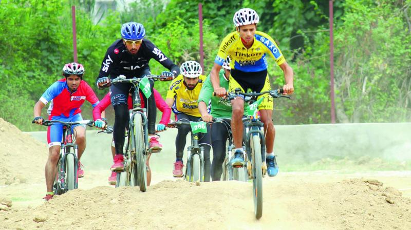 Kashmiri boys ride bikes in Srinagar during a sports event. (Photo: H.U. Naqash)