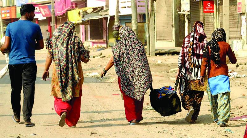 A families leaves riot-affected Karawal Nagar in northeast Delhi on Wednesday. (Photo: Pritam Bandyopadhyay)