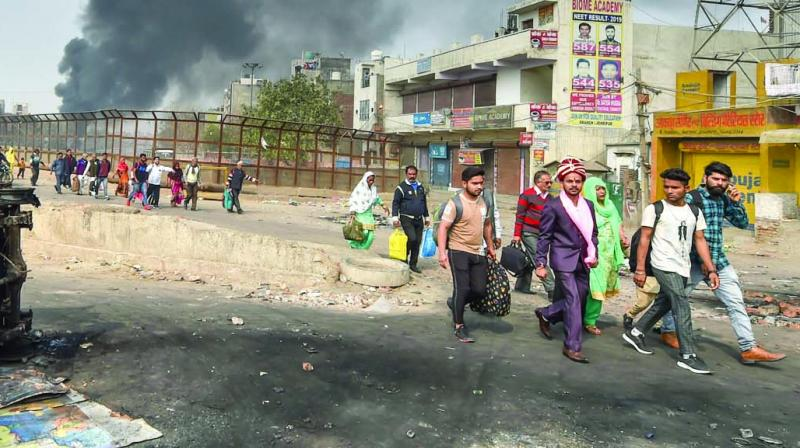 A bridegroom along with relatives heads for his wedding as they walk past Bhagirathi Vihar area. (Photo: BIPLAB BANERJEE)