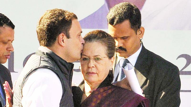 Newly-elected Congress president Rahul Gandhi greets his mother and predecessor Sonia Gandhi after her speech at the party headquarters in New Delhi. (Photo: Pritam Bandyopadhyay)